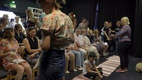 Spectators take their places before the performance in the small auditorium of the chamber theater