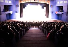 Spectators in the theater or in the cinema. Children and adults. Full house Royalty Free Stock Images