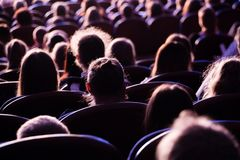 Spectators in the theater or in the cinema. Children and adults. Full house Stock Photography