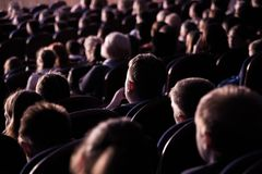 Spectators in the theater or in the cinema. Children and adults. Full house royalty free stock photos