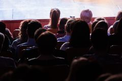 Spectators at a theater performance, in a cinema or at a concert. Shooting from behind. The audience in the hall stock photos