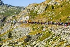 Spectators - Tour de France 2015. Col de la Croix de Fer, France - 25 July 2015: Spectators waiting for the peloton during the passing of The Publicity Caravan stock image