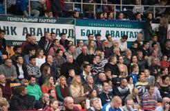 Spectators on tribune. MOSCOW - NOVEMBER 2, 2016: Unidentified spectators on tribune on game Dynamo MSK vs Dynamo KZN on Russian National wemen Volleyball Stock Photo