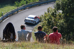 Spectators at the uphill race Royalty Free Stock Image