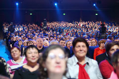 Spectators and videographers at concert Stock Image
