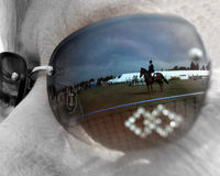 Spectators View. The reflection of a horse and rider in a show jumping arena Royalty Free Stock Photos
