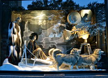 Spectators view holiday window display at Bergdorf Goodman in NYC. Stock Images