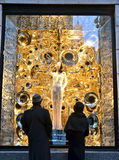 Spectators view holiday window display at Bergdorf Goodman in NYC. Royalty Free Stock Image