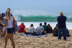Spectators watching big California surf Royalty Free Stock Photo