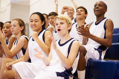 Spectators Watching High School Basketball Team Match Stock Image
