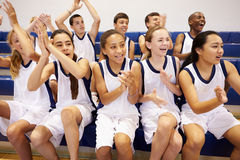 Spectators Watching High School Basketball Team Match Stock Images