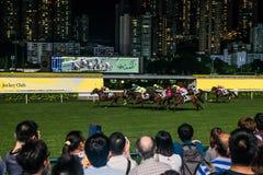 Spectators watching horse races Happy Valley racecourse Hong Kon Stock Photo