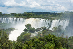 Spectators watching Iguazu Falls from observation deck Stock Images