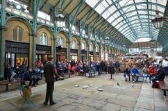 Spectators watching street show in Covent Garden in London, UK Stock Photos