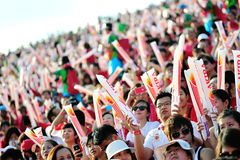 Spectators waving clappers during NDP 2012 Stock Images