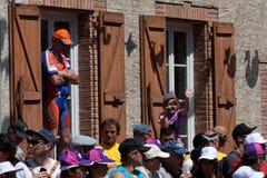 Spectators wearing caps Stock Images