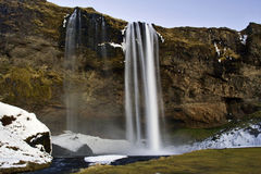The Spectoral Beauty of the Icy Seljalandsfoss Waterfall, Iceland Royalty Free Stock Image