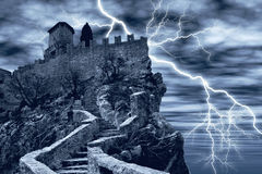 Spectral castle. Dark castle surrounded by lightning Royalty Free Stock Photography