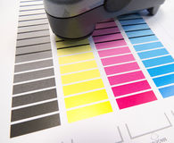 Spectrometer On Colour Chart. Printing colour charts for measuring colour values and control in printing industry using a spectrometer royalty free stock photos