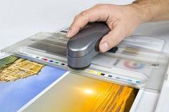 Spectrophotometer measurement of CMYK color stripe. Offset print controll. Spectrophotometer measurement of CMYK color stripe stock image