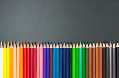 Color pencils set. Spectrum color pencils set isolated on black background royalty free stock photos
