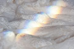 Spectrum on lace. Decomposition of light into a spectrum on lace royalty free stock photo