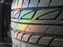 Spectrum rainbow light. On stack of car wheels stock photo