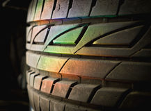Spectrum rainbow light. On stack of car wheels with color filter effect stock photography