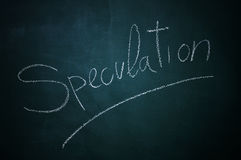 Speculation. Word speculation written with chalk in a chalkboard Royalty Free Stock Images