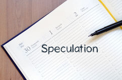 Speculation write on notebook. Speculation text concept write on notebook with pen Stock Images