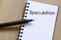 Speculation write on notebook. Speculation text concept write on notebook with pen Stock Photography