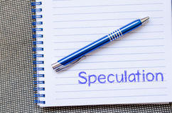 Speculation write on notebook. Speculation text concept write on notebook with pen Royalty Free Stock Images