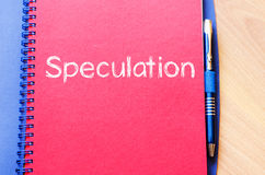 Speculation write on notebook Royalty Free Stock Photos