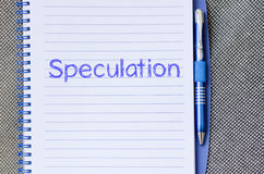 Speculation write on notebook. Speculation text concept write on notebook with pen Royalty Free Stock Photography