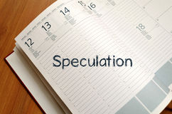 Speculation write on notebook. Speculation text concept write on notebook with pen Royalty Free Stock Photos