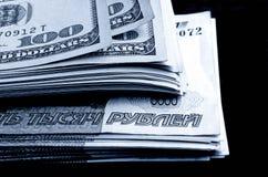 Speculazione di valuta il dollaro della rublo Fotografia Stock