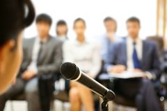 During speech. Image of microphone being used by speaker during lecture at conference Stock Image