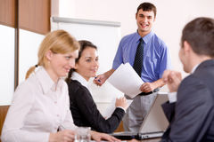 Speech. Confident manager pronounces a speech at business meeting