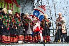 Speech amateur choral collective during Shrovetide celebrations, Gomel, Belarus. GOMEL, BELARUS - MARCH 12, 2016: Speech amateur choral collective during royalty free stock image