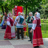 Speech of amateur ensemble in national Belarusian costumes Royalty Free Stock Images
