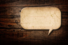 Speech Bubble. Blank Recycle paper Speech Bubble on wood background Stock Photography