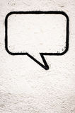 Speech bubble. At a wall - space for text Stock Images