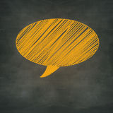 Speech bubble on blankboard, communication concept Royalty Free Stock Images