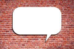 Speech Bubble on the brick wall. Blank speech bubble on the brick wall Stock Images