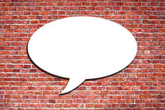 Speech Bubble on the brick wall Royalty Free Stock Image