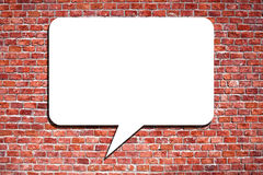 Speech Bubble on the brick wall. Blank speech bubble on the brick wall Stock Photo