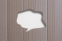 Speech bubble carved in cardboard Royalty Free Stock Photos