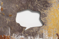 Speech bubble carved in metal rusty wall. 3D rendering of blank speech bubbles carved in brown rusty metal wall Royalty Free Stock Images