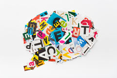 Speech bubble letters in cut out magazine. Stock Image