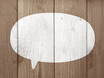 Speech Bubble. Over Brown Wood Texture Royalty Free Stock Photos